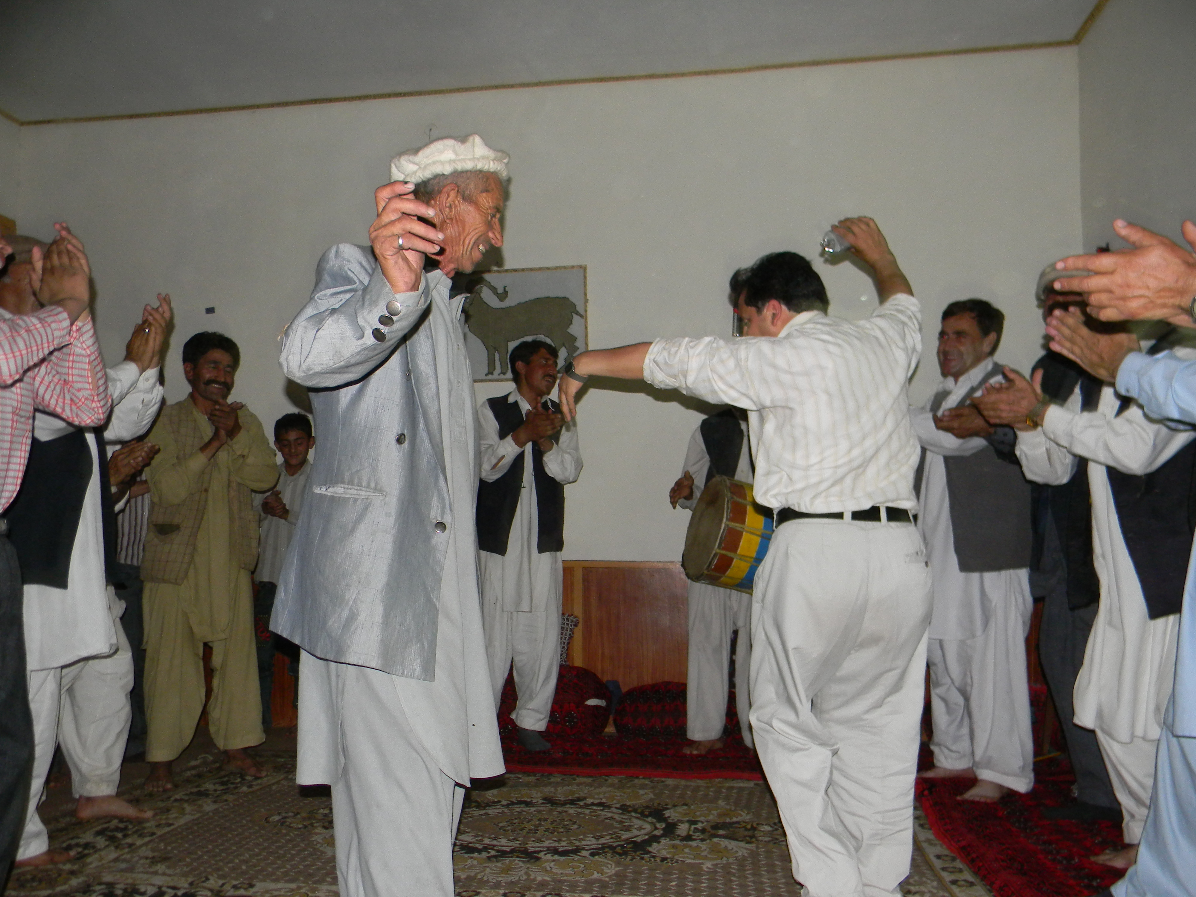 Hundur_men dancing during traditional music and song performance